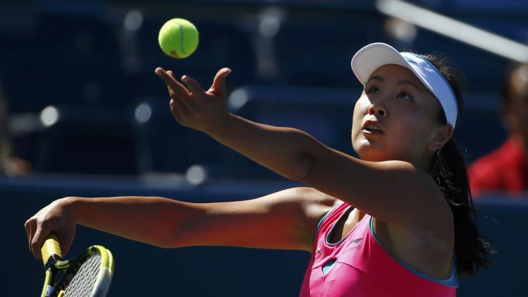 Peng Shuai of China serves to Roberta Vinci of Italy during their match at the 2014 U.S. Open tennis tournament in New York