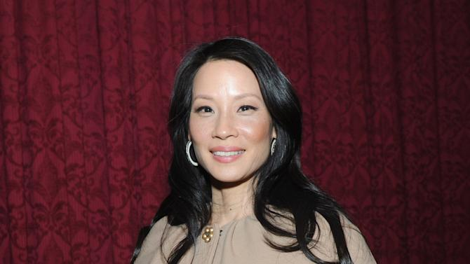 Lucy Liu is honored at the 32nd annual Muse Awards presented by New York Women in Film & Television (NYWIFT), Thursday, Dec. 13, 2012, in New York.   The event also honored actress Mariska Hargitay, Kim Martin, President & General Manager WE tv, Lisa F. Jackson, documentary filmmaker, and Debra Zimmerman, of Women Make Movies.  (Diane Bondareff/Invision for  NYWIFT/AP Images)