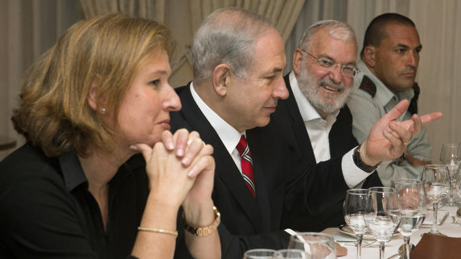 Tzipi Livni, Israel's chief negotiator with the Palestinians, left, sits next to Israel's Prime Minister Benjamin Netanyahu, with Yaakov Amidror, National Security Advisor to the Prime Minister, and Military Secretary Major General Eyal Zamir, as Netanyahu meets with U.S. Secretary of State John Kerry, unseen, in Jerusalem on Saturday, June 29, 2013. Kerry kept up his frenetic Mideast diplomacy Saturday, shuttling again between Palestinian and Israeli leaders in hopes of restarting peace talks. (AP Photo/Jacquelyn Martin, Pool)