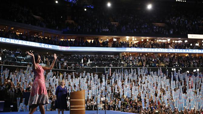 First Lady Michelle Obama waves to delegates at the Democratic National Convention in Charlotte, N.C., on Monday, Sept. 3, 2012. (AP Photo/Jae C. Hong)
