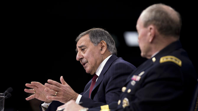 Defense Secretary Leon Panetta, accompanied by Joint Chiefs Chairman Gen. Martin Dempsey, gestures during a news conference at the Pentagon, Thursday, Jan. 10, 2013. Panetta said he is asking his department to begin taking steps to freeze civilian hiring, delay some contract awards and curtail some maintenance to prepare for drastic budget cuts if Congress can't reach an agreement on a final spending plan.  (AP Photo/ Evan Vucci)