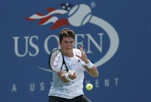Raonic of Canada hits a return to Lopez of Spain at the U.S. Open tennis championships in New York