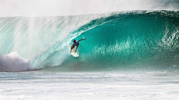 Kieren Perrow of Australia surfs inside a Pipeline barrel during the Billabong Pipe Masters on December 8, 2011 in North Shore, United States.