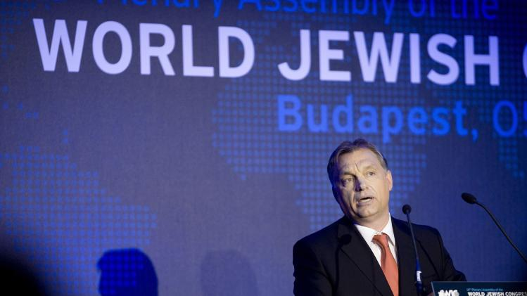 Hungarian Prime Minister Viktor Orban delivers his speech during the opening dinner of the World Jewish Congress in Budapest, Hungary, Sunday, May 5, 2013. (AP Photo/MTI, Szilard Koszticsak)