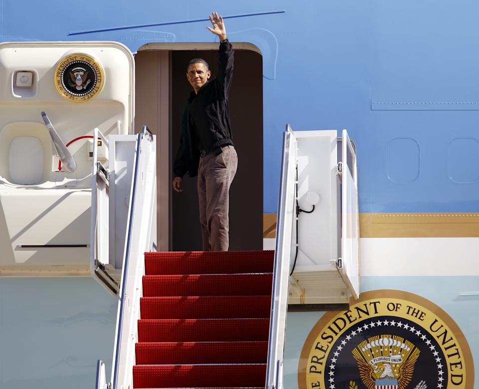 President Barack Obama waves from Air Force One before departing at Andrews Air Force Base, Md. on Sunday, Oct. 17,  2010, on route to  to Ohio for an pre-election rally. (AP Photo/Jose Luis Magana)