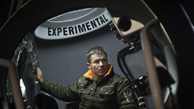 This image provided by Red Bull Stratos shows pilot Felix Baumgartner of Austria sitting in his capsule in preparation for the final manned flight of Red Bull Stratos in Roswell, N.M., Tuesday Oct. 9, 2012. Extreme athlete and skydiver Baumgartner canceled his planned death-defying 23-mile free fall on Tuesday because of high winds, the second time this week he was forced to postpone his quest to be the first supersonic skydiver. (AP Photo/Red Bull Stratos)