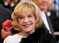 French actress Jeanne Moreau smiles as she arrives at the 61st Cannes International Film Festival in 2008. Moreau lights up the big screen at the Locarno Film Festival Saturday in a film inspired by a story of friendship between two Estonian women in Paris