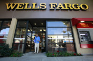<p>               FILE - In this Jan. 18, 2011 file photo, a customer exits a Wells Fargo bank branch in Los Angeles. Wells Fargo & Co. said Monday, Oct. 17, 2011, its third-quarter profit jumped 21 percent, as write offs of bad loans dropped while deposits grew.(AP Photo/Reed Saxon, file)