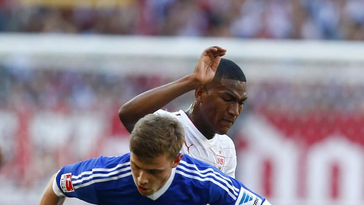 Stuttgart's Gruezo challenges Schalke 04's Meyer during their German Bundesliga first division soccer match in Stuttgart