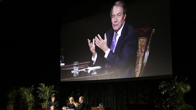 Journalist Charlie Rose, at bottom right and on screen, makes opening comments during an interview with Rory Kennedy, center, and Robert F. Kennedy Jr., left, in front of a full audience at the AT&T Performing Arts Center Friday, Jan. 11, 2013, in Dallas, Texas.  The Kennedys are in Dallas as a year of observances begins for the 50th anniversary of President John F. Kennedy's assassination. (AP Photo/Tony Gutierrez)
