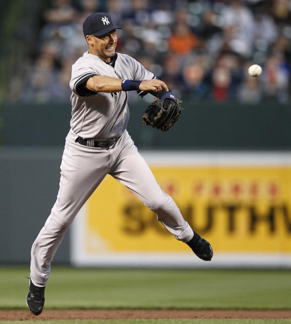 New York Yankees shortstop Derek Jeter throws to first base for an out after fielding a ground ball that was hit by Baltimore Orioles' J.J. Hardy in the first inning of a baseball game in Baltimore, Monday, April 9, 2012. (AP Photo/Patrick Semansky)