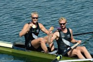 New Zealand's Eric Murray (L) and Hamish Bond pose on their boat after receiving their gold medal for the men's pair final of the rowing event during the London 2012 Olympic Games, at Eton Dorney Rowing Centre in Eton, west of London, on August 3. With N.Z. unexpectedly leading Australia in the medal table, Kiwi media are mocking their trans-Tasman rivals' modest success so far at the Games