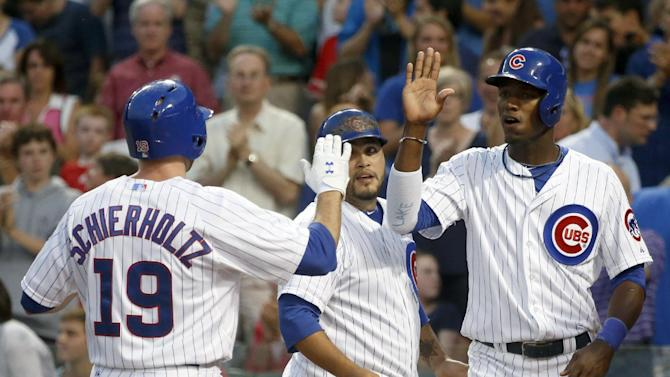 Schierholtz powers Cubs past Nationals 11-1