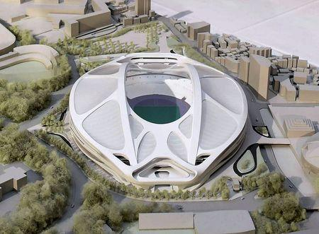 A rendering model of the new National Stadium for 2020 Tokyo Olympics and Paralympics, designed by Iraqi-British architect Zaha Hadid, is displayed at a meeting in Tokyo