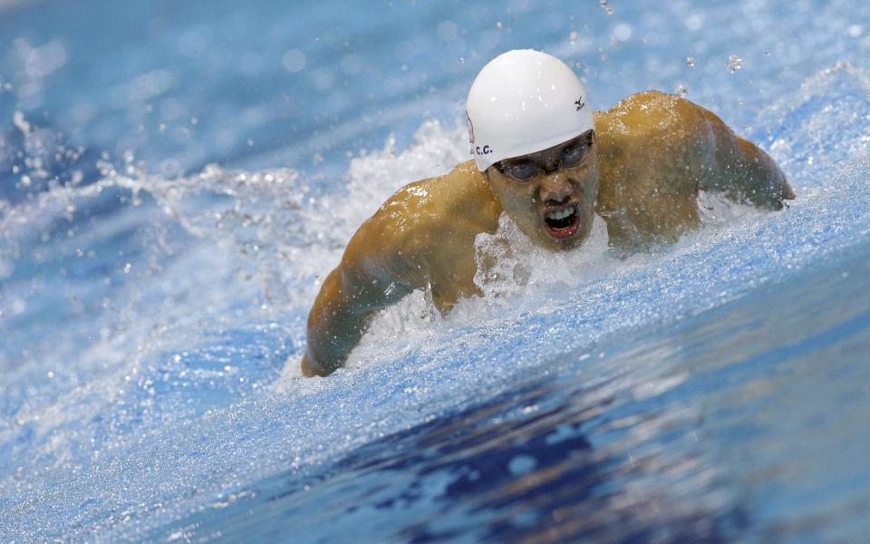 Taiwan's Hsu Chi-Chieh competes in a men's 200-meter butterfly swimming heat at the Aquatics Centre in the Olympic Park during the 2012 Summer Olympics in London, Monday, July 30, 2012. (AP Photo/Michael Sohn)
