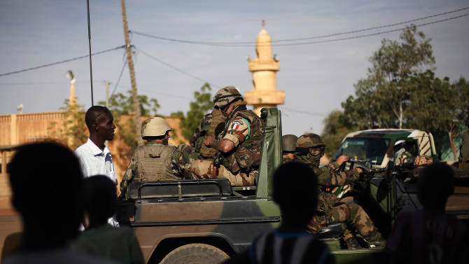 """French troops are seen  in Gao, northern Mali, Tuesday Jan. 29, 2013, days after Malian and French military forces closed in and retook the town from Islamist rebels. Earlier Tuesday, four suspected extremists were arrested after being found by a youth militia calling themselves the """"Gao Patrolmen"""". Malian soldiers prevented the mob from lynching them. (AP Photo/Jerome Delay)"""