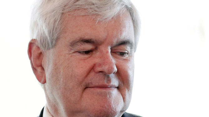 Republican presidential candidate, former House Speaker Newt Gingrich paues after a being a guest on a radio interview in the Hollywood Diner in Dover, Del., Thursday, April 12, 2012. (AP Photo/Patrick Semansky)