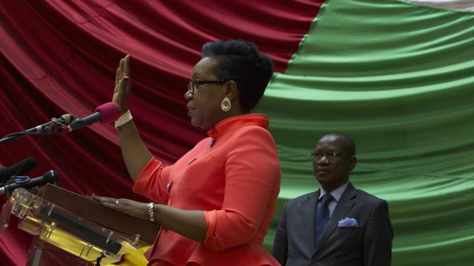 New parliamentary-elected interim President of the Central African Republic Samba-Panza swears an oath during her swearing-in ceremony at the National Assembly in the capital Bangui