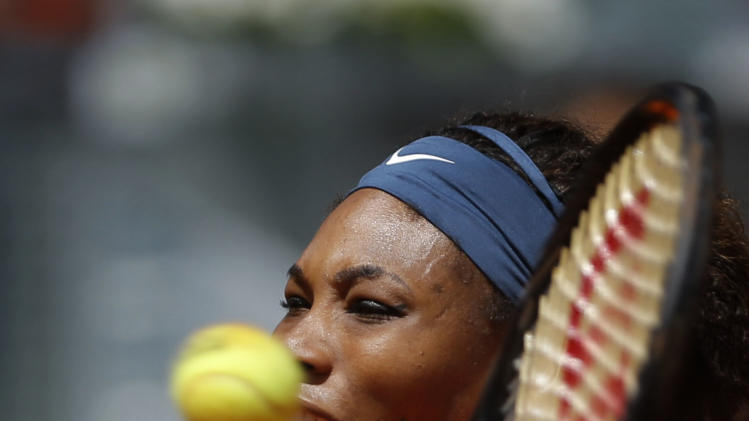 Serena Williams from U.S. returns the ball to Anabel Medina from Spain, during the Madrid Open tennis tournament, in Madrid,  Friday, May 10, 2013. (AP Photo/Daniel Ochoa de Olza)