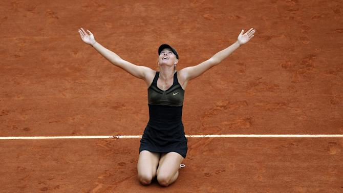 FILE - In this June 9, 2012 file photo, Maria Sharapova, of Russia, reacts after defeating Sara Errani, of Italy, 6-3, 6-2 in their women's final match in the French Open tennis tournament at the Roland Garros stadium in Paris. Sharapova dropped to the clay in both celebration and disbelief after becoming the 10th woman to complete the tennis version of a career Grand Slam. (AP Photo/David Vincent, File)