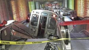 A derailed commuter train rests on an escalator at O'Hare international airport in Chicago