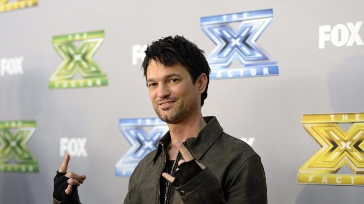 "Finalist Jeff Gutt poses backstage after ""The X Factor"" finale in Los Angeles"