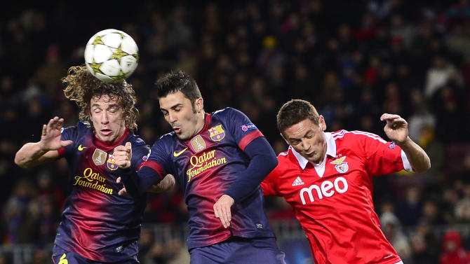 FC Barcelona's Carles Puyol, left, and David Villa, center, duel for the ball against Benfica's Nemanja Matic, from Serbia, during a group G Champions League soccer match at the Camp Nou stadium in Barcelona, Spain, Wednesday, Dec. 5, 2012. (AP Photo/Manu Fernandez)