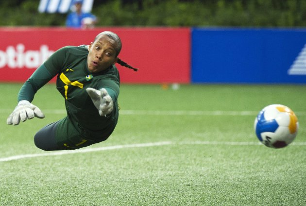 Brazil goalie Barbara Barbosa makes a diving save against Canada during second half of the gold medal women's soccer match at the Pan American Games in Guadalajara, Mexico on Thursday, Oct. 27, 2011.