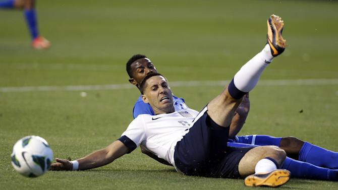Honduras' Jose Velasquez, rear, and United States' Clint Dempsey battle for a ball in the second half during a World Cup qualifying soccer match at Rio Tinto Stadium on Tuesday, June 18, 2013, in Sandy, Utah. The United States defeated Honduras 1-0.  (AP Photo/Rick Bowmer)