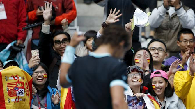 Fans cheers Rafa Nadal of Spain after he beat Fabio Fognini of Italy during their men's singles semifinal match at the China Open tennis tournament in Beijing
