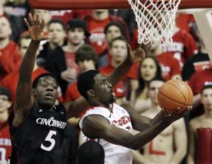 Rice gets 100th win, Rutgers beat Cincinnati 61-54