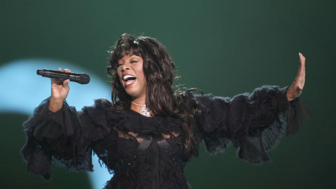 "FILE - In this Dec. 11, 2009 file photo, Donna Summer performs at the conclusion of the Nobel Peace concert in Oslo, Norway.  Summer, the Queen of Disco who ruled the dance floors with anthems like ""Last Dance,"" ""Love to Love You Baby"" and ""Bad Girl,"" has died. Her family announced her death in a statement Thursday, May 17, 2012.  She was 63.  (AP Photo/John McConnico, File)"