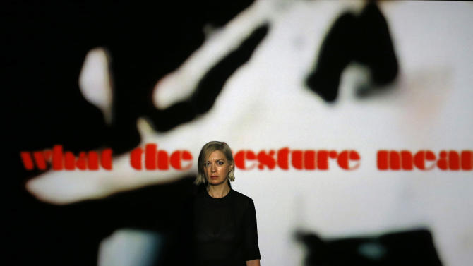 Elizabeth Price the winner of the Turner Prize 2012 stands with her video installation 'The Woolworths choir of 1979' at the Tate Britain art gallery in London, Monday, Dec. 3, 2012. (AP Photo/Kirsty Wigglesworth)