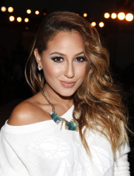 Adrienne Bailon attends the Abbey Dawn By Avril Lavigne Spring 2013 Runway Show on Monday, Sept. 10, 2012 in New York. (Photo by Amy Sussman/Invision/AP)