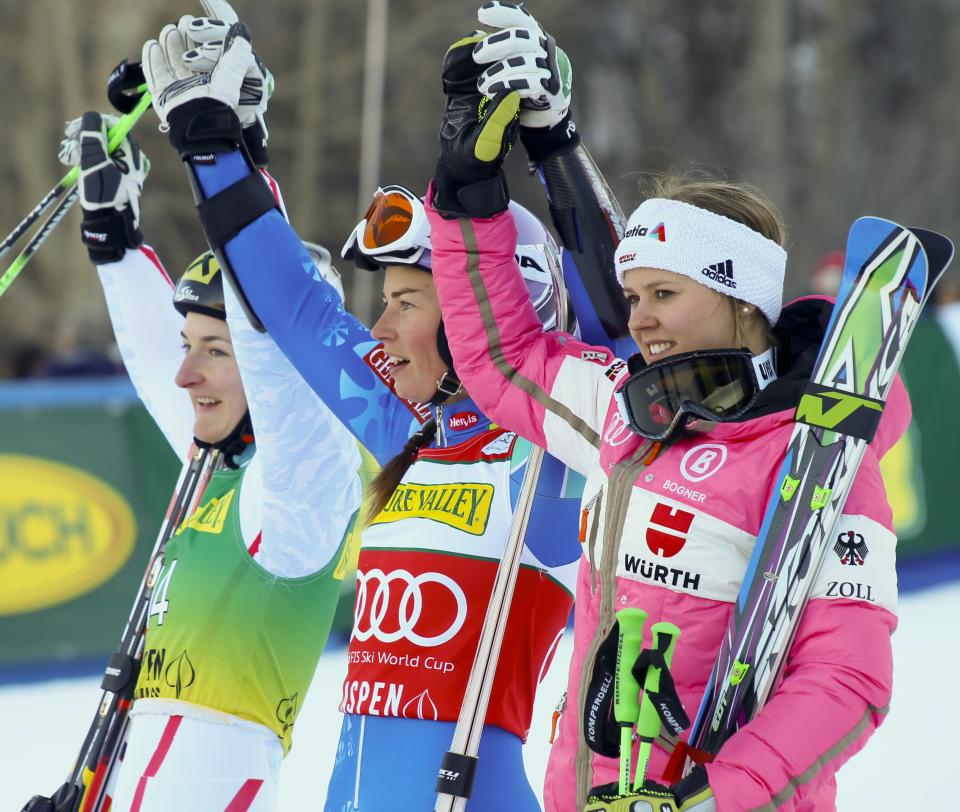 Kathrin Zettel, left, from Austria, second place, Tina Maze, center, from Slovenia, first place, and Viktoria Rebensburg, right, of Germany, third place celebrate after the women's World Cup giant slalom race in Aspen, Colo., on Saturday, Nov. 24, 2012.(AP Photo/ Nathan Bilow)