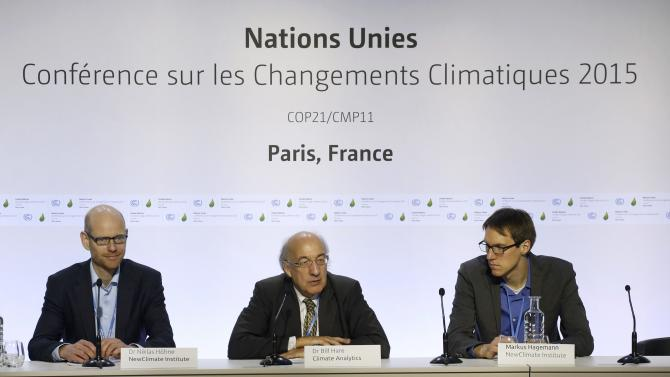 "Dr Hoehne, founding partner of NewClimate Institute, Bill Hare, founder and CEO of Climate Analytics, and Markus Hagemann, founding partner of NewClimate Institute, attend the ""Climate Action Tracker"" press conference during the COP21 at Le Bourget"