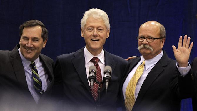 """Former President Bill Clinton, center, poses with Indiana Democratic Senate candidate Joe Donnelly, left, and Indiana Democratic gubernatorial candidate John Gregg, right, before Clinton spoke at """"Hoosier Common Sense"""" rally in Indianapolis, Friday, Oct. 12, 2012.  (AP Photo/Michael Conroy)"""