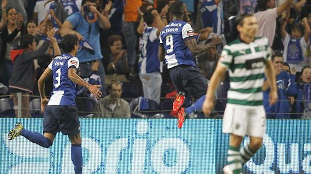 Porto's Jackson Martinez (9) celebrates his goal against Sporting Lisboa during their Portuguese Premier League match at the Dragao stadium in Porto (Reuters)