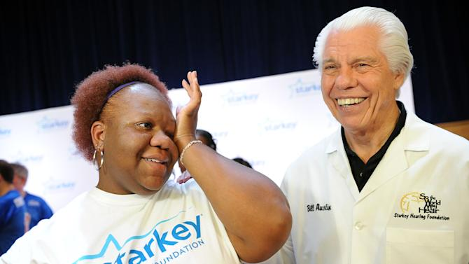 Donah Hawkins wipes away tears after Bill Austin, founder of Starkey Hearing Foundation, fits her with a new hearing aid on Saturday, Feb. 2, 2013 in New Orleans. (Photo by Cheryl Gerber/Invision for Starkey Hearing Foundation/AP Images)