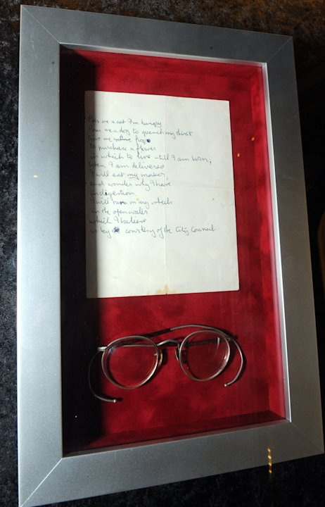 "John Lennon's iconic round glasses are displayed at the launch of Hard Rock International's traveling music memorabilia collection, ""Music GIves Back,"" Wednesday, Feb. 13, 2013, at Hard Rock Cafe New"