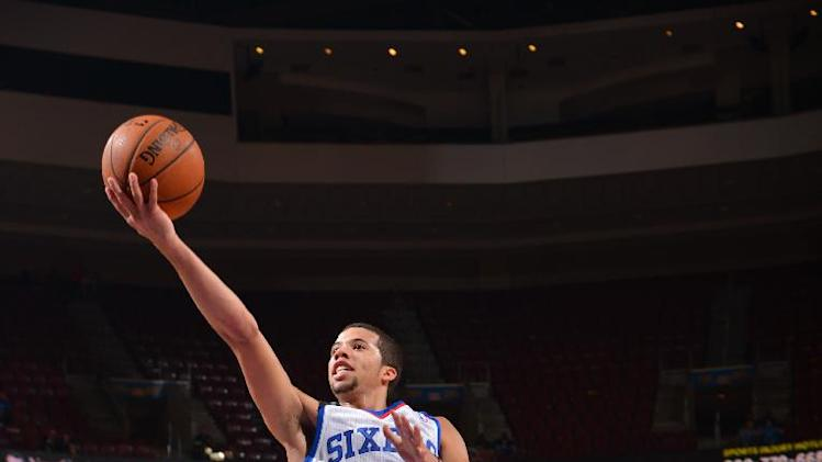 Carter-Williams leads 76ers past Magic in 2OT