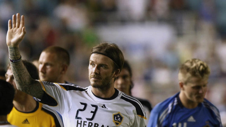 FILE - In this Saturday, Dec. 3, 2011 file photo, David Beckham of the Los Angeles Galaxy waves to the crowd while doing a victory lap following their 6-1 win over the Philippine Azkals at the Rizal Memorial Football Stadium . David Beckham will join Paris Saint-Germain on Thursday, Jan. 31, 2013, opting for a move to France after mulling over lucrative offers from around the world since leaving the Los Angeles Galaxy. The 37-year-old Beckham was to undergo a medical examination in the French capital before being officially presented as PSG's latest recruit, a person familiar with the situation told The Associated Press. The person spoke on condition of anonymity because the deal has not yet been completed.  The LA Galaxy team led by Beckham is here for the second leg of his team's 3-country-tour that included Indonesia and Australia. At right is teammate Brian Perk. (AP Photo/Bullit Marquez, File)