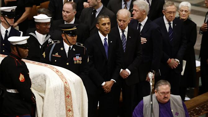 President Barack Obama, Vice President Joe Biden, former President Bill Clinton, and Senate Majority Leader Harry Reid of Nevada stand as the casket is brought in at the funeral service for the late Sen. Daniel Inouye, D-Hawaii, at the Washington National Cathedral, Friday, Dec. 21, 2012. (AP Photo/Charles Dharapak)