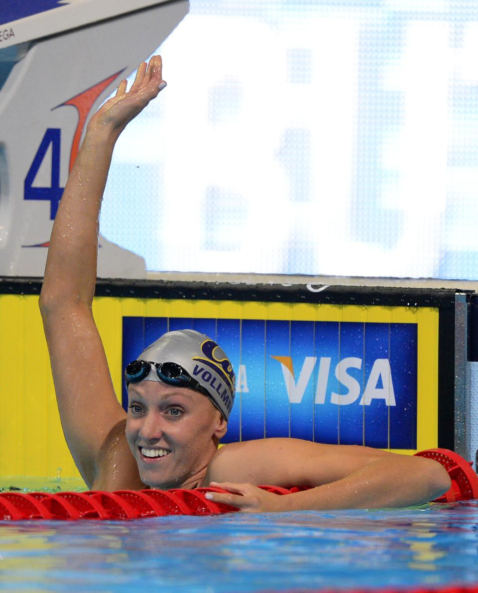 Dana Vollmer waves after swimming in the women's 100-meter butterfly preliminaries at the U.S. Olympic swimming trials, Monday, June 25, 2012, in Omaha, Neb. (AP Photo/Mark J. Terrill)