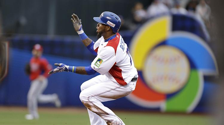 The Dominican Republic's Jose Reyes (7) celebrates after hitting a double against Puerto Rico during the first inning of the championship game of the World Baseball Classic in San Francisco, Tuesday, March 19, 2013. (AP Photo/Eric Risberg)