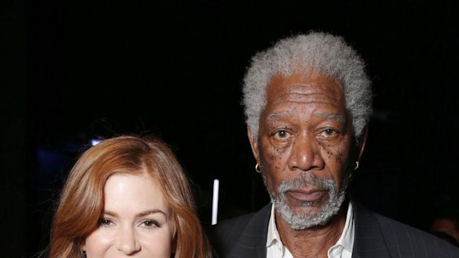 "Isla Fisher and Morgan Freeman, cast members in the upcoming film ""Now You See Me"" at Lionsgate Presentation at 2013 CinemaCon, on Thursday, April, 18th, 2013 in Las Vegas. (Photo by Eric Charbonneau/Invision for Lionsgate/AP Images)"