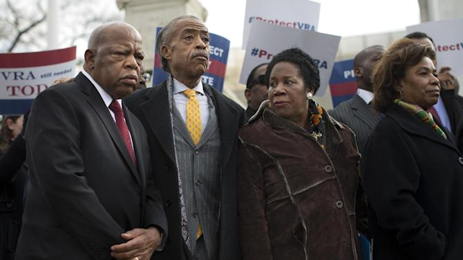 From left, Rep. John Lewis, D-Ga., Rev. Al Sharpton, Rep. Sheila Jackson Lee, D-Texas, and Rep. Barbara Lee, D-Calif., stand outside the Supreme Court in Washington, Wednesday, Feb. 27, 2013, during a rally before oral arguments in the Shelby County, Ala., v. Holder voting rights case. The justices are hearing arguments in a challenge to the part of the Voting Rights Act that forces places with a history of discrimination, mainly in the Deep South, to get approval before they make any change in the way elections are held. (AP Photo/Evan Vucci)