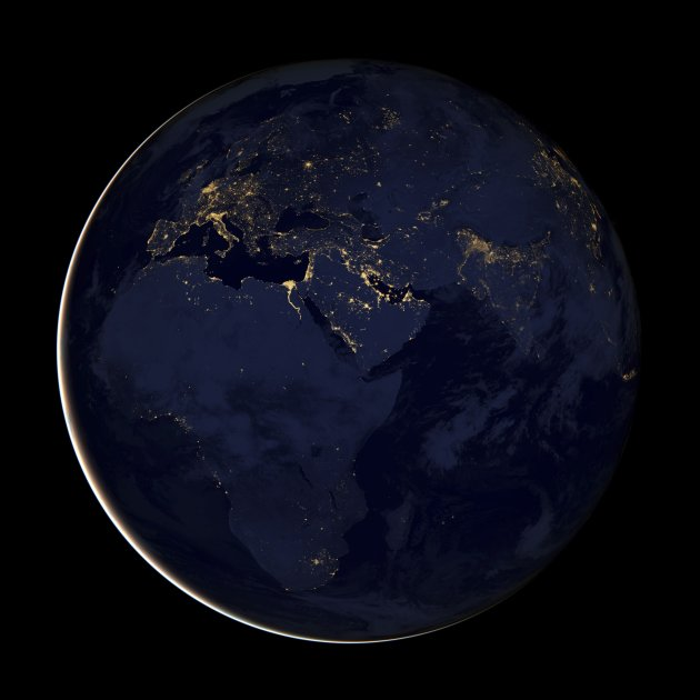 NASA Earth Observatory handout of a composite image of Europe, Africa, and the Middle East at night, assembled from data acquired by the Suomi NPP satellite in April and October 2012