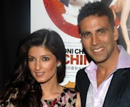 "FILE - In this Jan. 8, 2009 file photo, Bollywood stars, Akshay Kumar and his wife Twinkle Khanna attend the premiere of ""Chandni Chowk To China"" in New York. Kumar and Khanna have become parents of a baby girl. On Tuesday, Sept. 25, 2012, the actor tweeted that his new daughter ""looks just like her mother and grandmother & I have no words to express my happiness."" (AP Photo/Peter Kramer, File)"