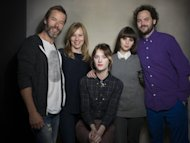 "From left, actors Guy Pearce, Amy Ryan, Mackenzie Davis, Felicity Jones and director Drake Doremus from the film ""Breathe In"" pose for a portrait during the 2013 Sundance Film Festival on Sunday, Jan. 20, 2013 in Park City, Utah. (Photo by Victoria Will/Invision/AP Images)"